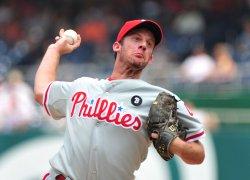 Philadelphia Phillies pitcher Roy Oswalt pitches in Washington.