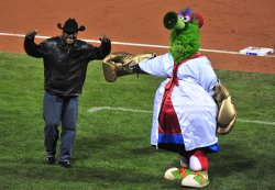 'Smokin' Joe Frazier is introduced by the Phillie Phanatic during game 4 of the world series in Philadelphia
