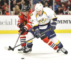 Blackhawks Hossa tries to steal puck from Predators Tootoo in Chicago