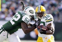 New York Jets David Harris shoves Green Bay Packers Brandon Jackson at New Meadowlands Stadium in New Jersey
