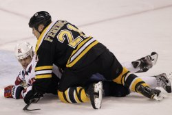 Bruins Fenrence tangles with Capitals Hendricks at TD Garden in Boston, MA.