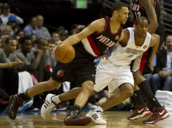 Blazers Roy Drives Against Nuggets Afflalo in Denver