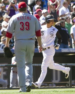 Rockies Gonzalez Scores Against Reds Pitcher Harang in Denver