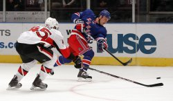 New York Rangers Sean Avery takes a slap shot against the Ottawa Senators in the first period at Madison Square Garden