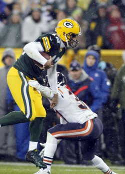 Packers Rodgers runs for yardage against the Bears in their game in Green Bay