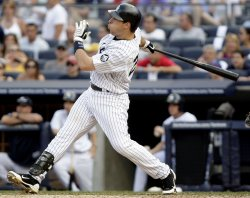 New York Yankees Mark Teixeira hits a solo homer at Yankees Stadium in New York