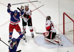 New York Rangers Brandon Dubinsky and Brian Boyle react after Boyle gets the puck by Ottawa Senators Craig Anderson at Madison Square Garden in New York