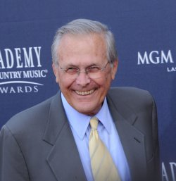 Former U.S. Secretary of Defense Donald Rumsfeld arrives at the 46th annual Country Music Awards in Las Vegas