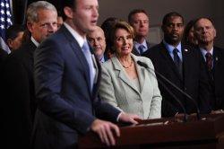 House Minority Leader Pelosi welcomes new members of Congress in Washington