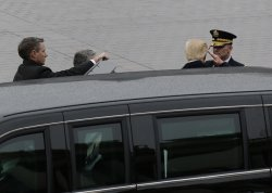 President Donald Trump salutes an officer