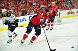 Capitals Brooks Laich clears the puck in Washington