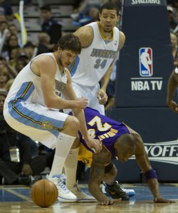 Lakers Bryant Loses Ball Against Nuggets Gallinari and McGee During the NBA Western Conference Playoffs First Round Game Six in Denver