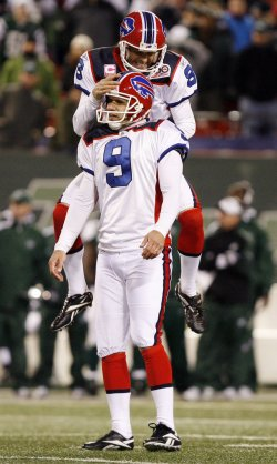 Buffalo Bills Brian Moorman leaaps on Rian Lindell (9) after Lindell kicks a 47 yard field goal to win the game in overtime against the New York Jets in week 6 of the NFL season at Giants Stadium in New Jersey