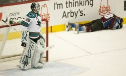 Sharks Goalie Nabokov Looks at Fallen Avalanche Center Mueller in Denver