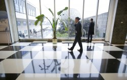 People walks through the lobby of the United Nations Building