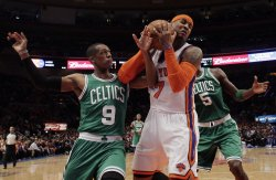 New York Knicks Jared Jeffries tries to block a shot from Boston Celtics Rajon Rondo at Madison Square Garden in New York