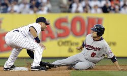 New York Yankees Derek Jeter tags out Minnesota Twins Jamey Carrol at Yankee Stadium in New York