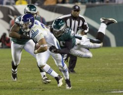 Philadelphia Eagles is airborne as he tries to tackle Indianapolis Colts Ernie Sims in the 4th quarter.