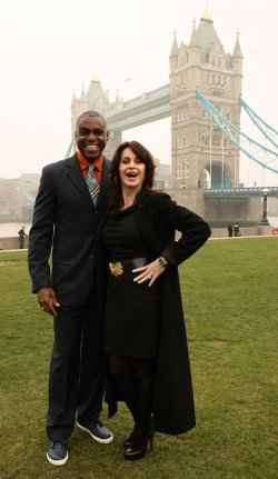 Carl Lewis poses with Nadia Comaneci