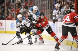 Sharks Wellwood, Eager Blackhawks Toews chase puck in Chicago
