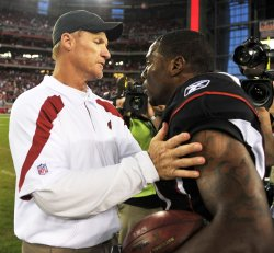 Whisenhunt congratulates Peterson after winning the Cardinals-Rams game in Arizona.