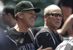 Rockies Manager Tracy Laughs with Coach Dauer in Denver
