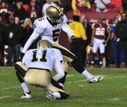 Saints' kicker Garrett Hartley kicks a field goal in Washington