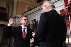 Sen. Mark Kirk (R-IL) is sworn in on Capitol Hill in Washington