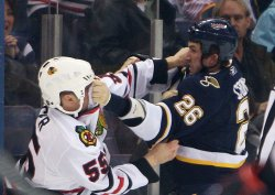 Chicago Blackhawks Ben Eager and St. Louis Blues BJ Crombeen