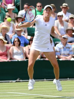 Justine Henin plays a backhand on the third day of Wimbledon.