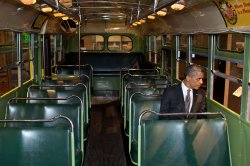 Obama sits on Rosa Parks Bus in Detroit