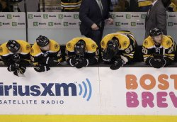 Bruins bench watch end of game against Capitals at TD Garden in Boston, MA.