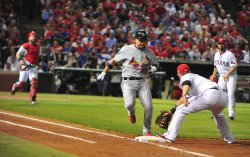 St. Louis Cardinals Rafael Furcal bunts for a base hit in game 5 of the World Series in Texas