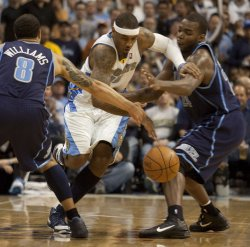Nuggets Anthony Dribbles Past Jazz Williams and Millsap in the NBA Western Conference Quarter-finals Game Five in Denver