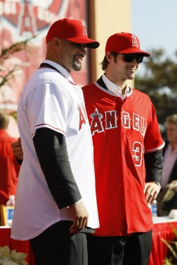 Los Angeles Angels' Albert Pujols is introduced to the media with their new pitcher C.J Wilson, during a news conference in Anaheim, California