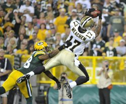 Saints Meachem catches touchdown pass against Packers in Green Bay, Wisconsin