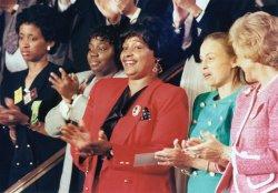Winnie Mandela applauds at Congress