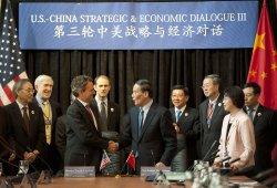 U.S. Treasury Secretary Tim Geithner shakes hands with Chinese Vice Premier Wang Qishan in Washington