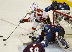 Flames Bourque Shoots Against Avalanche Goalie Anderson in Denver