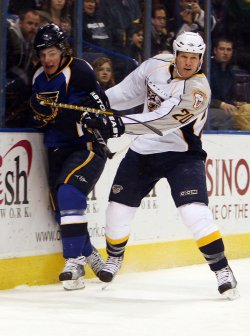 Nashville Predators Ryan Suter and St. Louis Blues TJ Oshie