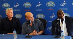 "Earvin ""Magic"" Johnson participates in a news conference to announce Dodgers blockbuster trade in Los Angeles"