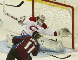 Canadiens Goalie Price Makes Save Against Avalanche Dupuis in Denver