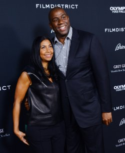 "Earvin ""Magic"" Johnson and wife Cookie attend the ""Olympus Has Fallen"" premiere in Los Angeles"