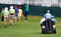 Corey Pavin (right) gets a ride during the TPC Players in Florida