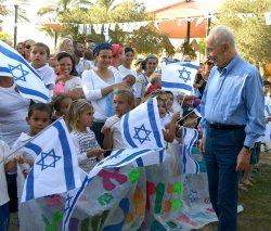File Photo of Israeli Leader Shimon Peres Greeting Children