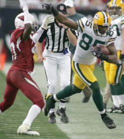 Packers' Greg Jennings runs out of bounds in Arizona