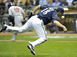Brewers' pitcher Shaun Marcum miss fields a ball during game 2 of the NLCS in Milwaukee