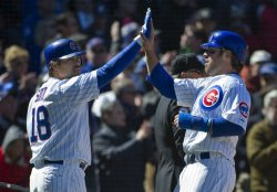 Cubs' Soto High-Fives Stewart on Opening Day in Chicago