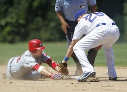 Cubs Baker tags out Reds Votto in Chicago