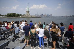 Tourists visit The Statue of Liberty